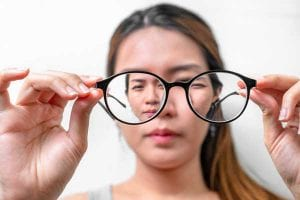 Woman with Myopia Looking through Glasses